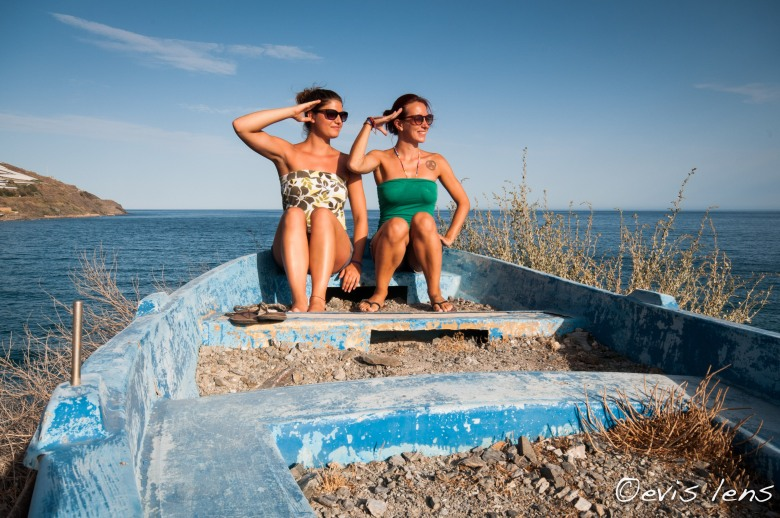 two,women,saluting,oldboat,Andalusia, Spain